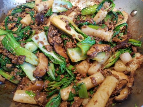 Sharing Plate Stir Fried Sticky Rice Cakes With Mushrooms And Bok Choy